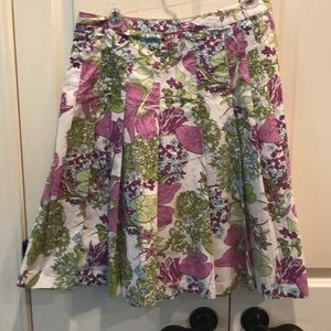 White, purple & green floral a-line pleated skirt